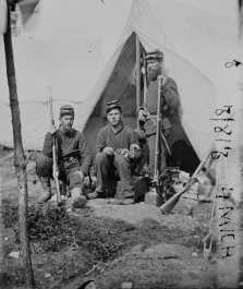 (L-R) Pvt. Andrew Kingsley, Co. B; Cpl. Frank Spelman, C. C; and Cpl. Eugene Vaughn, Co. C; all three enlisted from Indiana