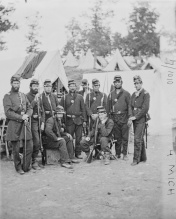 Members of Co. D, 4th Mich. Inf. at Fort Woodbury in the fall of 1861; 1st Lt. Jairus Hall at far right and Capt. John Randolph on far left