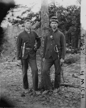 Reportedly two musicians of Co. F, 4th MI; one id'd as Frank F. Barnes but not on roster.