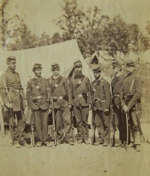 Co. I, 4th Michigan Infantry members (l-r): Lt. Mashall Chapin, Sgt. John M. Bancroft, Sgt. George Maltz, Cpl. John F. Cooper, Pvt. William G. Robinson, Cpl. John Kidd, and Lt. John A. Gordon (taken in Oct. of 1861); USAHEC