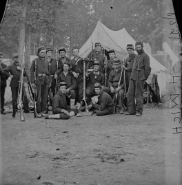 A group of men from the Fourth Michigan Infantry pose before the camera in the fall of 1861. The image has been attributed to the popular Civil War photographer, Mathew Brady, or one of his assistants. Brady took a handful of other outdoor photographs of the men of the regiment while they were encamped in northern Virginia.