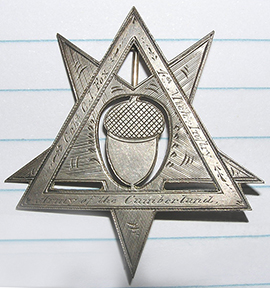 This double Corp badge belonged to Captain Charles J. Fox, Co. H of the Reorganized 4th Michigan Infantry. The triangle is the emblem representing his and the regiment's service in the 4th Corps, while the inverted star represents their service in the 20th Corps