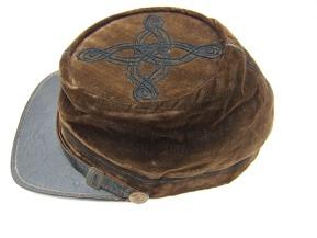 Moses Carleton's velvet kepi was originally a deep blue before the Texas sun turned it dark brown