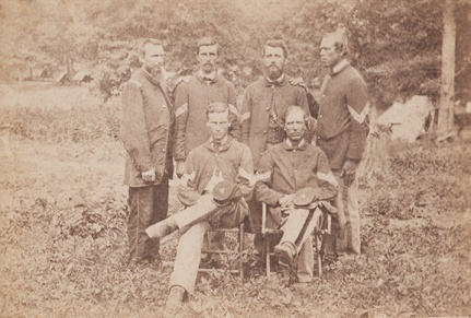 Men of the Reorg. 4th Mich. Inf. with Sgt Henry Dake standing on the right side in 2nd row