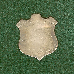 The silver identification badge belonging to Pvt. Hiram l. Hartson of Co. E, 4th Mich.