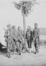 Men from Co. H, from left-right, Corp. Cornelius Hadley, Pvt. Jesee L. Hadley, Sgt. William Lindsey, Sgt. Alonzo B. Van Scooter, and 1st Lt. Simon B. hadley