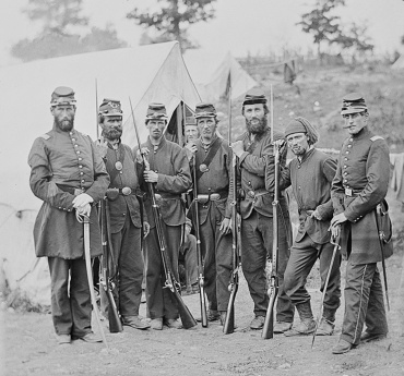 Men of Company D with 1st Lieut. Jarius Hall at far right