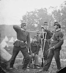 Men of the 4th Michigan in a mock sword fight (Marshall Chapin seated in center)